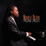 Neville sitting at the piano